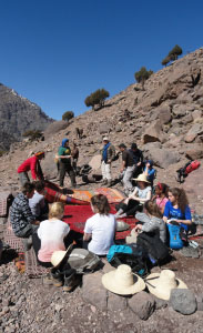 Students enjoying a picnic in the High Atlas Mountains, Morocco