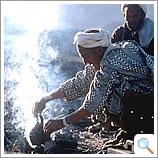 Berber preparing mint tea